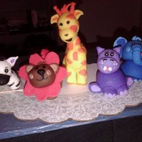 Fondant Safari Animals These are all made of fondant and hand-crafted to match the party decorations chosen for the celebration. The zebra was the first and the...