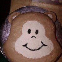 Monkey Face Cake This was made for the child to dig into n his 1st birthday. The ears are made of sandwich cookies covered in frosting. This cake goes with...