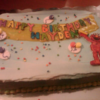 Elmo Throws A Birthday Party Elmo & the lettering are made of gum paste. The banner is made of sparkle gel. I also purchased the royal icing balloons. An...