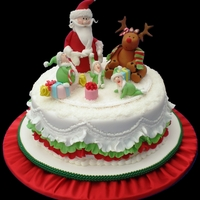 Christmas Cake - Raquel Palacios 20cm fruit cake covered in a layer of almond paste and then RTR. 100% edible, all figurines hand made with love.