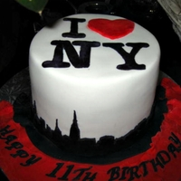 New York City Cake Made for a girl who loves New York and will be visiting for first time this spring. N.Y. logo on top and skyline on side.