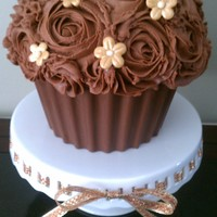Chocolate Rose Cupcake Chocolate giant cupcake with buttercream roses, gold blossoms and chocolate cupcake liner. First time making fondant flowers and the...