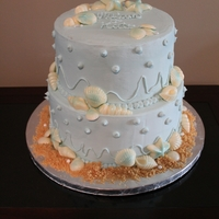 Beach Themed Cake My first time making a tiered buttercream cake. All handmade white chocolate shells brushed with sapphire and pearl shimmer.