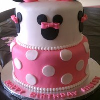 Minnie Mouse 1St Birthday First girly cake ever. Not flawless, but I was happy with it, nevertheless. Bow turned out better than I expected.