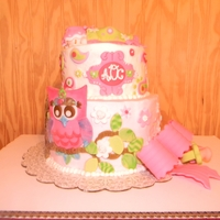 Tinas Paisley Owl Baby Shower Cake With Bow This is a cake I did for my friend Tina to match her Paisley Whimsical Owl Baby Shower Invites. All decorations are fondant and the cake is...