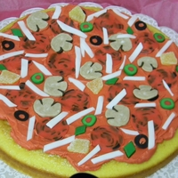 "Kaseys Pizza Birthday Yellow Cake with buttercream ""pizza sauce"" and loaded with fondant toppings. Yum"