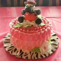 Ambers Baby Zebra On A Pink Petal Cake With Flowers This was my first attempt at an ombre petal cake for my friend Ambers baby shower. It is a three layer vanilla cake filled with cream...
