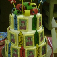 2012 Nacs Preschool Graduation Cake 3 tiered funfetti cake iced with butter cream. Bow and star are made of fondant. Pictures are edible. Frames are made of gumpaste and royal...