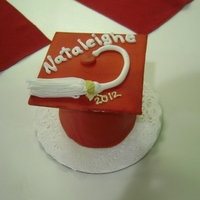 Mini Graduation Caps I made 20 of these for each of my preschool graduates. Chocolate cake covered with red fondant. Tops are made of gumpaste (i recommend...