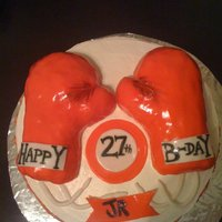 Boxing Gloves Cake My brother really wanted a boxing cake for his birthday. Gloves are made out of RKT, covered in fondant. Had a lot of fun molding and...