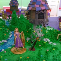 Rapunzel Tower Cake 1/2 sheet cake with mounds covered in grass. Edible tower, trees, river, rocks, etc.