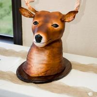 Mounted Deer Head Grooms Cake Base Of The Cake Is Red Velvet And Head Is Rice Cereal Treats Covered In Mmf Ears And Antlers Are Gumpast  Mounted deer head groom's cake. Base of the cake is Red Velvet and head is rice cereal treats, covered in mmf, ears and antlers are...