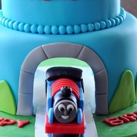 Thomas The Train Real Tunnel Cake   I wanted to make a cake that had a real tunnel going through it. Thomas is made out of fondant.