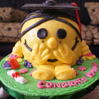 Little Miss Sunshine Grad Cake   Chocolate cake with Ferrero Roacher Filling... covered in Fondant.