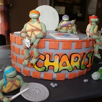 Teenage Mutant Ninja Turtles Inspired by Tea Party Cakes and I will say I tried to copy it......but to no avail. lol I was given a photo and asked to recreate the cake...