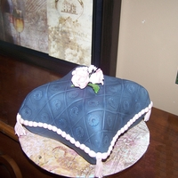 Jordan's Birthday Pillow cake covered in fondant, gum paste roses and leaves
