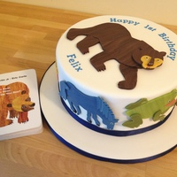 Brown Bear, Brown Bear First Birthday Cake  The birthday boy's favourite book is Brown Bear, Brown Bear, so this cake features animals from the book cut out of marbled modelling...