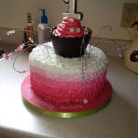 Ombré Buttercream First Birthday Cake  Chocolate cake with ombré ruffles in buttercream topped with a carvers oversized cupcake as the smash cake and wire beaded...