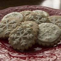 Snowflake Cookies Piped snowflake design on chai spiced sugar cookies