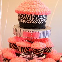 Zebra Cupcake Tower giant cupcake (for the birthday girl) and regular cupcakes.....Part of a dessert bar I created for my daughter's 2nd birthday that was...