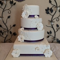 4 Tier Round And Square Wedding Cake Purple And Bling 4 tier round and square wedding cake. Purple and bling