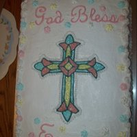 Baptism Stained glass cross outlined in buttercream and filled with lightly tinted piping gel