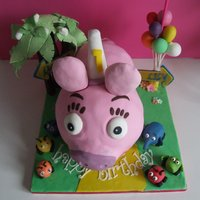 Jungle Junction Zooter Cake Marble cake with hand made decorations, request was for the cake to be Zooter the little pig, not so little here, all figures are hand made...