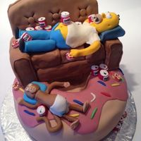 Simpsons Birthday Cake  Homer and Mojo on top of a donut cake! The chair is made from Rice Krispie treats and the characters and beer cans are made from fondant....