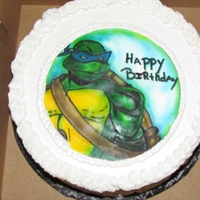 Leo Waldorf Astoria cake and frosting Airbrushed Ninja Turtle on frosting sheet.