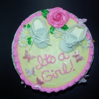 Baby Shower Cake Chocolate cake with cookies and cream filling. The little shoes are made out of gumpaste.