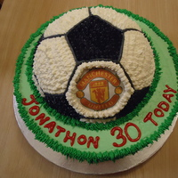 Manchester United Soccer Ball I made this cake for a friends 30th Birthday. The Man Utd. decal is edible icing paper.