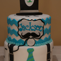 Gentleman's Mustache Cake With Top Hat And Smash Cake A cake for a little gentleman's first Birthday! Red velvet, yellow cake, cream cheese filled, with fondant and gumpaste decoration.
