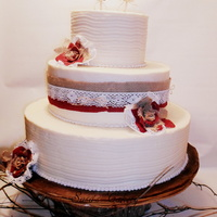 3 Tier Butter Cream Wedding Cake With Burlaplace Ribbon Amp Roses With A Wooden Love Birds Topper 3 tier butter cream wedding cake with burlap/Lace ribbon & roses with a wooden Love Birds Topper