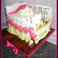 Baby Crib Cake 3D baby crib cake with a baby butt inside crib, the end panels are free hand painted