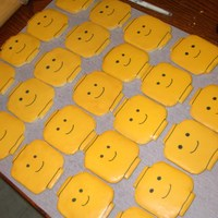 "3"" Lego Head Cookies hand cut these. covered them with glaze let dry overnight and then drew the face on using a black edible pen"