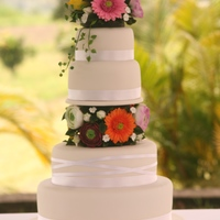 Gerberas Wedding Cake Four tiers wedding Cake, with gerberas and Ranunculus flower, all handmade and edibles
