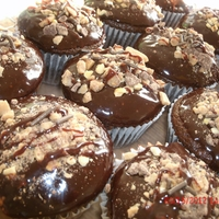 Chocolate Ganache Cupcake Chocolate ganache cupcake with whipped peanut butter filling and heath bar topping.