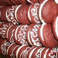 Red Velvet Sandwich Cookie RED VELVET SANDWICH COOKIE, WITH CREAM CHEESE FILLING AND WHITE CHOCOLATE DECORATIONS...