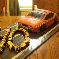 Dodge Charger Birthday Cake Chocolate cake covered in MMF and cake balls