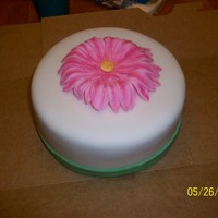 "My First Gerber Daisy! This is a small 6"" WASC cake with strawberry cream cheese filling. I covered the cake with mmf. The green band is mmf and the gerber..."