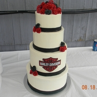 Harley Davidson Wedding Harley emblem was hand cut with an exacto knife out of black fondant. Then each letter and each red line hand cut with exacto knife out of...