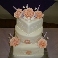 Wedding Cake With Flowers! 3 tier wedding cake with gumpaste flowers and rolled fondant.