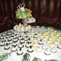 Nature Themed Wedding Cake/cupcakes Nature or woodsy themed cake and cupcakes with yellow and orange as the main cake colors.