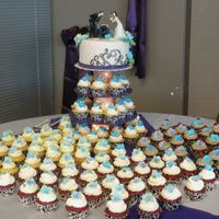 Wedding Cake/cupcakes Black and white damask theme wedding cake and cupcakes with purple tulips and hydrangreas.