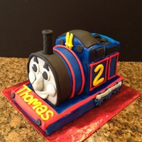 Thomas The Tank Engine Full 3D Thomas cake, my client gave me a picture of a train cake but the face, whistles, wheels, etc were plastic and these are fondant....