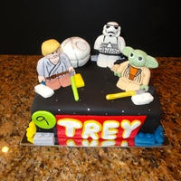 Lego Star Wars Fondant figures on a fondant cake. The death star is cake. I loved making this!