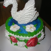 Swan Cake Chocolate cake with vanilla icing, and piping gel for the water and all flowers and swan are made with royal icing...