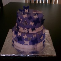 "Purple Butterflies I made this 2 tier (8"" and 10"") cake for Mother's Day for my purple fanatic mom! I'm still a newbie, so I get to..."