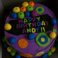 "Neon Circles Birthday Cake I did this 9"" 2 layer round with yellow cake and a caramel cheescake filling. Iced in purple buttercream, and fondant decorations. The..."