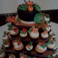 Wedding Cake And Cupcakes Fall themed cake and cupcake tower. Leaves, pumpkins and acorns are all fondant as is the cake.